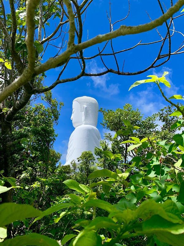 Buddha against the blue sky