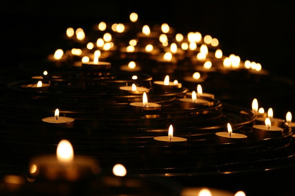 Multiple candles lighting up the darkness