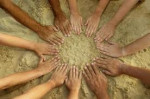 People placing their hands into a circle