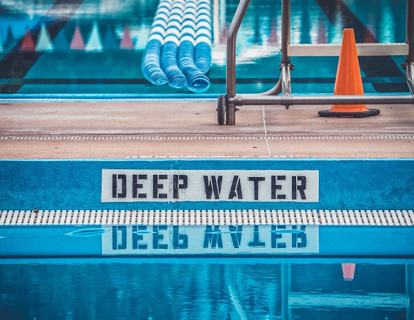 Deep water warning sign by a pool
