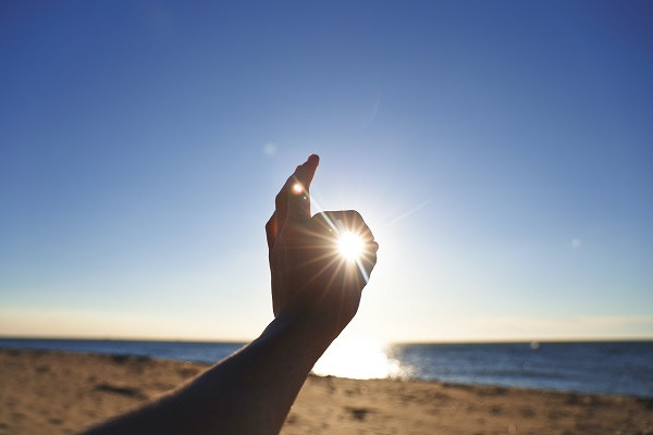 Hand around the sun